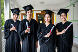 Group of multiethnic students with diplomas. - 200832116