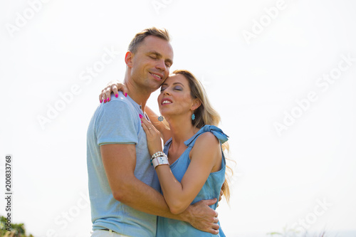 Loving couple embracing outdoors