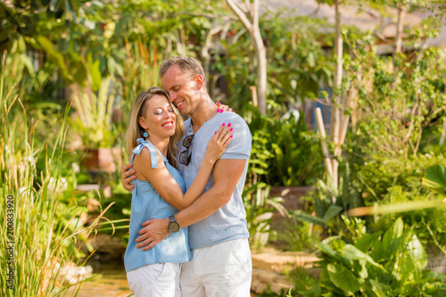 Loving couple embrace outdoors