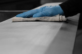 man cleaning a metal panel with a cloth preparing for spraying - 200839106