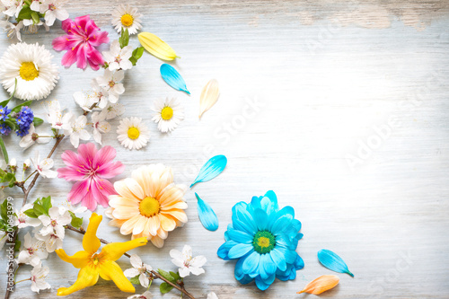 Spring summer flowers on wooden retro planks abstract floral background