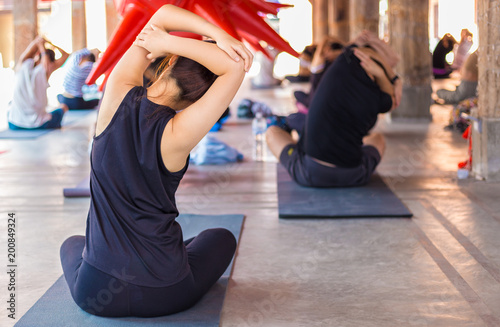 Foto op Aluminium School de yoga Group of people gathering to practic yoga at a commuinity place, for healthy lifestyle