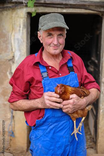 Happy Farmer with Organic Chicken