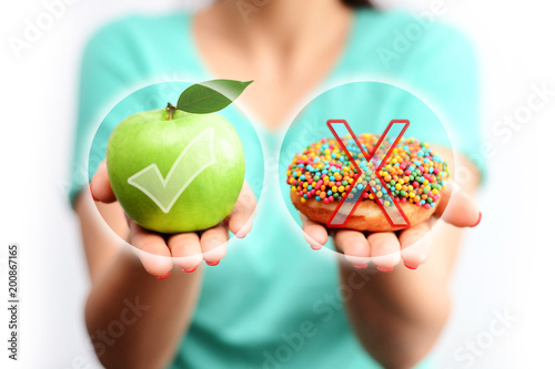 Foto Murales Healthy lifestyle concept, choose healthy fruits and not processed sweets
