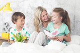 Fototapety Happy Family - Children congratulate their mom on Mother's Day
