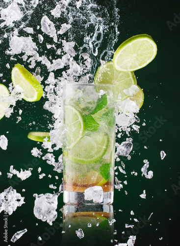 fresh mojito drink with liquid splash and crushed ice in freeze motion. - 200874740