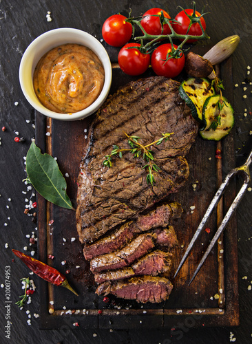 Delicious beef rump steak on wooden table - 200874953