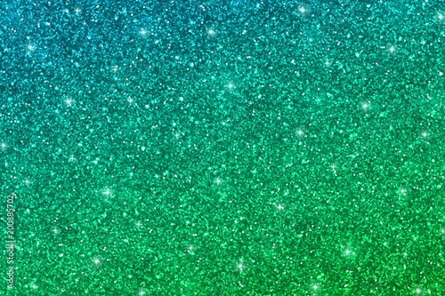 Fototapeta Glitter texture with blue green gradient