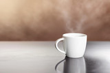 white hot coffee cup on wooden table