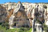 Remains of ancient pigeon coops carved into natural volcanic rock formations in Goreme, Cappadocia (Turkey).