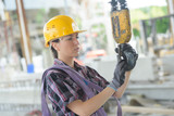 woman working on crane - 200900979
