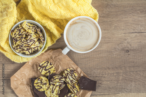 Fotobehang Chocolade Cup of coffee with milk, chocolate, delicious nutritious cereal breads