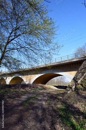 Railway bridge, in very scenic landscape with river in germany, at Leipzig