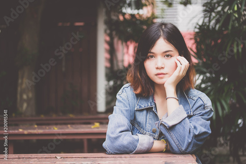 Portrait of thai adult beautiful girl short hair relax time, in Vintage Style