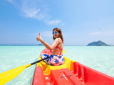 Asian woman on the kayak boat in Andaman blue sea and blue sky background location in Phuket island Thailand - 200918971