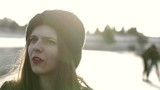 Beautiful young woman talking at the sunset - 200919580