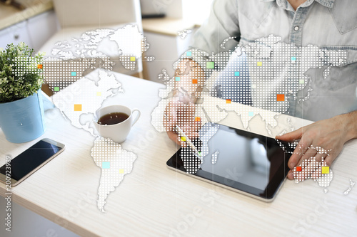 Foto Murales Worlds maps on virtual screen. Business, internet and technology concept.