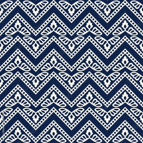 Woodblock printed indigo dye seamless ethnic floral geometric pattern. Traditional oriental ornament of India Kashmir flowers with chevron motif, navy blue on ecru  background. Textile design.