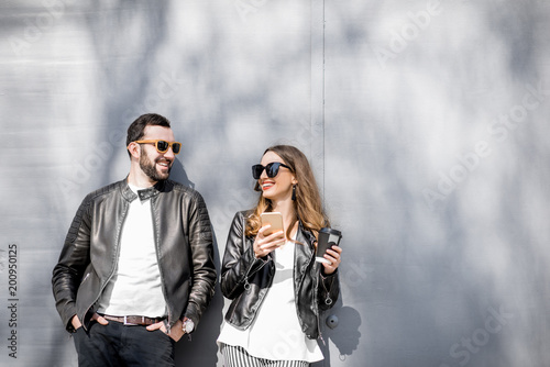 Stylish couple on the grey background