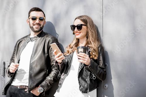 Stylish couple on the grey background
