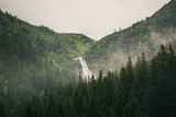 Summer landscape. Hiking Outdoor Concept. Rocky waterfall in the mountains. Balea waterfall