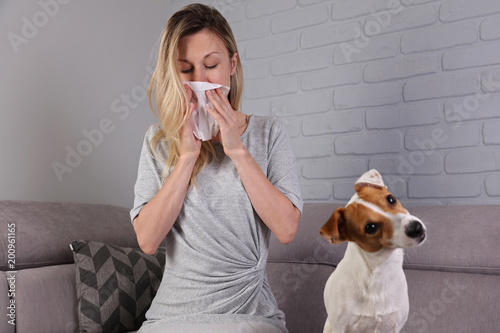 Man having pet allergy symptoms : runny nose, asthma