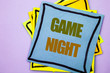 Writing text showing  Game Night. Business photo showcasing Entertainment Fun Play Time Event For Gaming written on sticky note paper on the pink background.