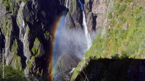 Voringfossen / Vøringsfossen waterfall rainbow in seamless endless timelapse during holidays travelling near Eidfjord Norway Europe