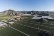 Aerial view of Camarillo farm fields, industrial buildings and the Santa Monica Mountains in Ventura County, California.