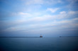 Minimalist blue lake view with distant pier