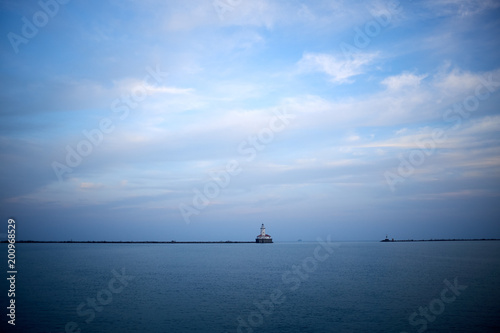 Fotobehang Chicago Minimalist blue lake view with distant pier