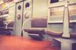 Vintage style New York City subway car interior with retro filter