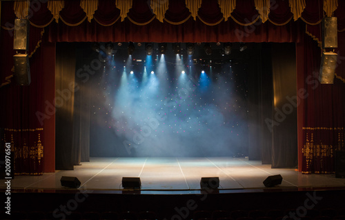Foto Murales scene, stage light with colored spotlights and smoke