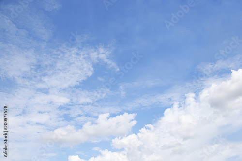 Blue sky background and white clouds soft focus, and empty space