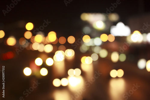 Gold bokeh abstract light background from car on road.