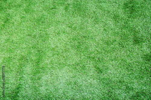 Green artificial grass texture or background and copy space