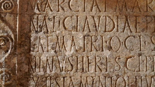 Carved words in stone panel at ancient Roman ruins at the archaelogical UNESCO Heritage site of Volubilis in Morocco.