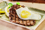 steak with egg and mashed potato