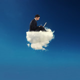 Businessman connected with his laptop over a cloud. concept of social network and internet addiction