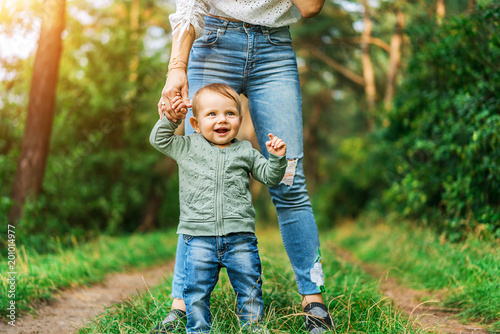 mother with her little daughter playing outdoor