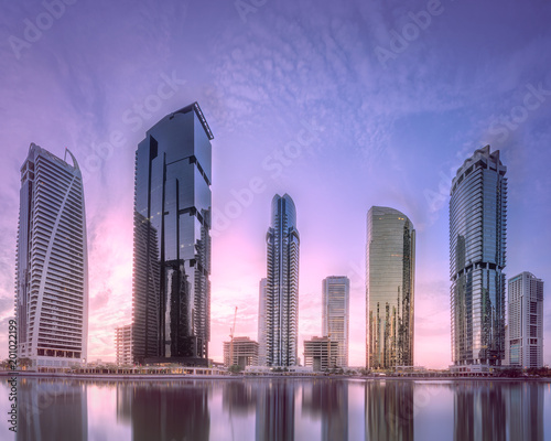 Foto op Plexiglas Dubai Jumeirah Lakes Towers in Dubai at purple sunrise
