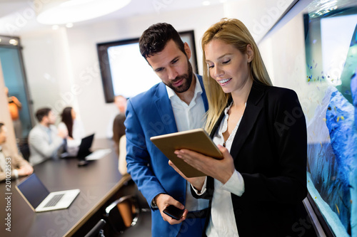 Fridge magnet Attractive business couple using tablet in their company