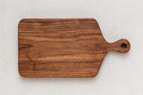 Walnut handmade wood cutting board on the linen - 201029166