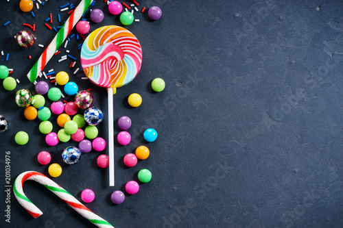 Foto Murales Colorful chocolate candies and lollipops.