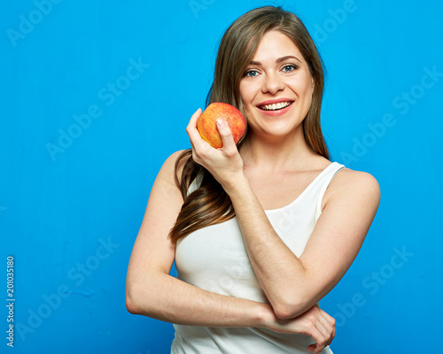 Foto Murales Smiling woman holding red apple. Toothy smile.