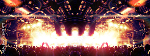 Wide angle view of a concert arena with ecstatic people