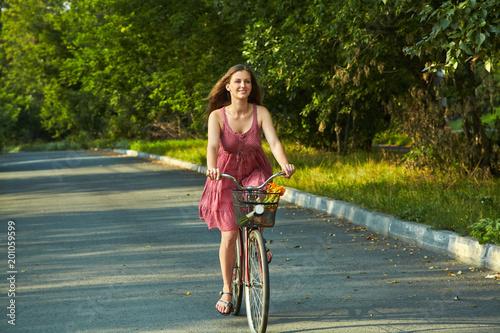 woman riding a bike. motion blur
