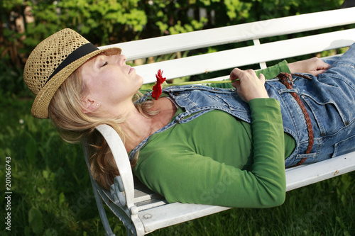 Wall mural Woman relaxing in the garden,42 years