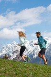 Couple of male and female athletes train in the mountains - 201067912