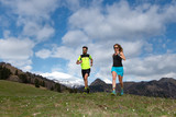 Couple of male and female athletes train in the mountains - 201067924